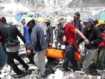 Members of the IMG team carrying the injured Italian climber this afternoon. Mark Tucker is on front right, Justin Mearle is two behind. Dennis is behind me. Photo Fiona Adler.