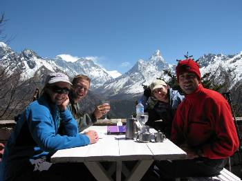 Enjoying drinks and views of Everest & Ama Dablam from the Everest View Hotel. Everest has the cloud plume coming off it.