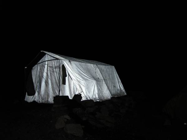 Our dining tent looms ghostly in the moonlight. Photo Paul Adler.