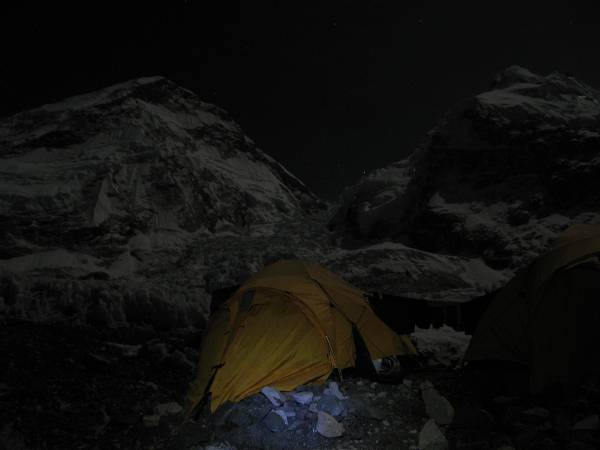 The West Shoulder of Everest and the Khumbu Icefall under moonlight. My two tents are in the foreground, along with my frozen washing! Photo Paul Adler.