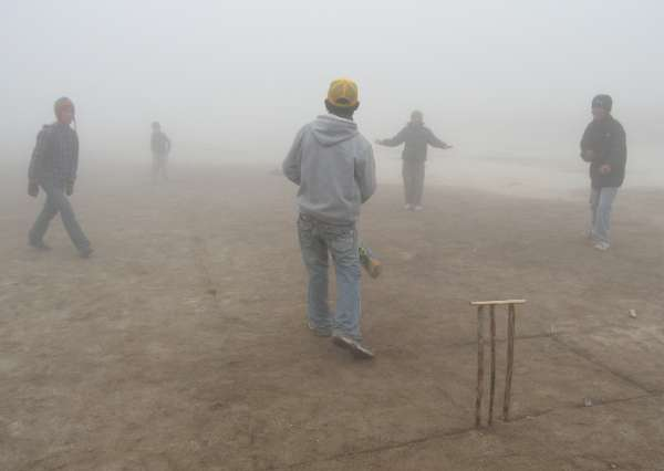 Nepali children playing cricket in the Hillary school ground. It was very foggy - you can just make out the bowler in the photo. Photo Paul Adler.