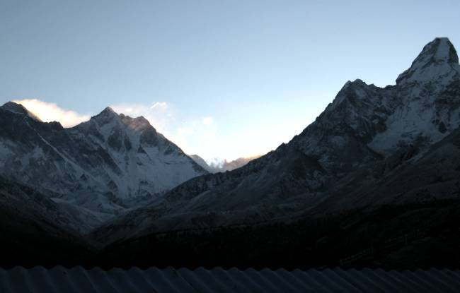 Tim took this photo from his bedroom window at sunrise today. Everest is at the far left with the banner cloud streaming off to the right. Photo Tim Adler.